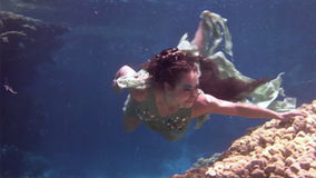 Underwater model free diver swims in clean transparent blue water in Red Sea. stock video