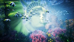 Underwater ocean waves ripple with tropical fish and statue of liberty. Looped stock video