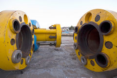 Underwater oil or gas pipes/drilling risers. Large yellow steel pipes used for subsea or underwater oil and gas transport stock image