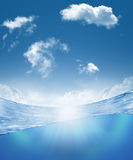 Underwater part and skylight splitted by waterline Stock Photos