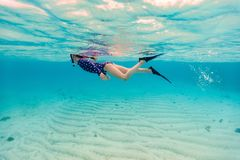 Little girl snorkeling stock photography