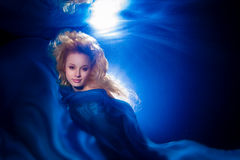 Underwater photo pretty young girl with blond long hair wearing royalty free stock photography