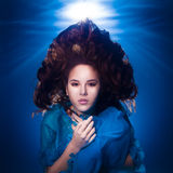 Underwater photo pretty young girl with dark long hair wearing b Stock Photos