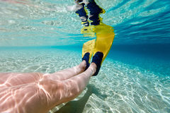 Underwater photo of  woman legs with fins Stock Images