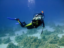 Underwater photographer. Diver with camera in deep and bubbles. Underwater photographer stock image
