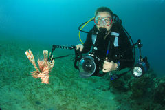 Underwater Photographer and Lionfish Royalty Free Stock Photography