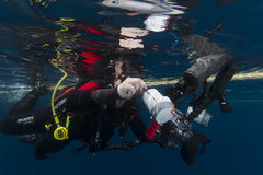 Underwater photographer at water surface Royalty Free Stock Photography