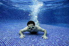 Underwater picture. Of a man swimming Stock Photo