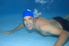 Underwater picture. Of a man (on thirties) swimming Stock Photo
