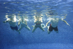 Underwater picture. Of friends having fun in the swimming-pool Royalty Free Stock Images
