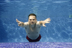 Underwater picture. Of a youg man swimming Stock Photo