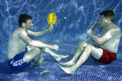 Underwater picture. A picture two young men playing underwater Stock Photography