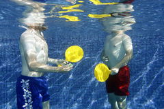 Underwater picture. A picture two young men playing underwater Royalty Free Stock Images