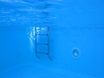 Underwater picture of a swimmingpool. Underwater picture of a swimming pool; concept of isolation, fear and other feelings Stock Photos
