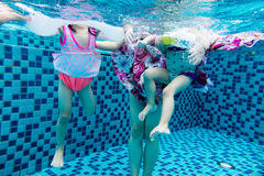 Underwater pohto of legs of the Asian Chinese family Stock Image