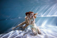 Underwater in the pool with the purest water. Loving couple hugging. The feeling of love and closeness. Soft focus. Underwater in the pool with the purest water stock photos