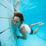 Underwater in a pool. Woman freediving underwater in a pool Stock Photos