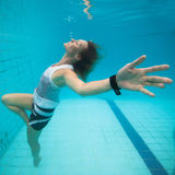 Underwater in a pool. Woman freediving underwater in a pool Stock Photography