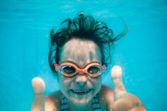 Underwater portrait of child. Kid having fun in swimming pool. Underwater portrait of child. Summer vacation Royalty Free Stock Image