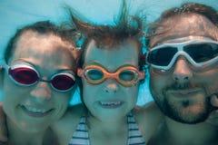 Underwater portrait of family Stock Photography