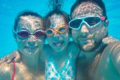 Underwater portrait of family Stock Photos