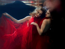 Underwater portrait ot two young beautiful girls Royalty Free Stock Images