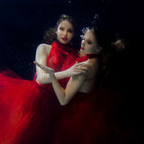 Underwater portrait ot two young beautiful girls Royalty Free Stock Photo