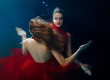 Underwater portrait ot two young beautiful girls Royalty Free Stock Photos