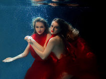 Underwater portrait ot two young beautiful girls Royalty Free Stock Image