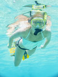 Underwater portrait of a woman snorkeling in clear tropical sea Royalty Free Stock Photo