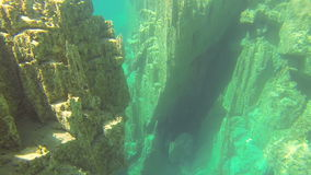 Underwater rocks on the bottom of the lakes. Underwater Sunrays Rocks on the bottom of the lakes stock footage