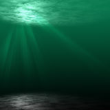 Underwater scene . Underwater scene with bottom of the sea and rays of ligth falling through  waves Royalty Free Stock Images