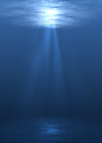 Underwater scene. With sun rays shining through water surface Royalty Free Stock Images