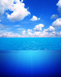 Underwater scene and blue sky Royalty Free Stock Photo