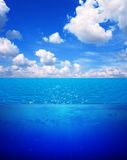 Underwater scene and blue sky Royalty Free Stock Images