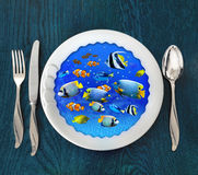 Underwater scene on plate. Photomanipulation, concept graphic. Royalty Free Stock Photos
