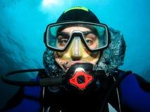 Underwater scuba diver making self portrait or selfie. stock images