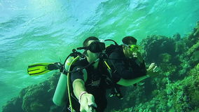 Underwater Scuba Diving Tourists with an Instructor in Red Sea,. EGYPT, SOUTH SINAI, SHARM EL SHEIKH, DECEMBER 7, 2016: Underwater Scuba Diving Tourists with an stock video footage