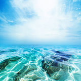 Underwater Sea Beach background / Blue waves and blue sky. Close up macro royalty free stock image