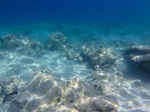 UNDERWATER sea level photo of the Aponissos beach, Agistri island, Saronic Gulf, Attica, Greece. UNDERWATER sea level photo of the Aponissos beach, Agistri royalty free stock photo