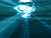 Underwater , sea surface with sunbeam shining