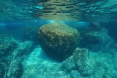 Underwater seascape large rock below water surface Royalty Free Stock Image