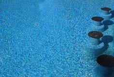 Underwater seats in a luxury resort pool Royalty Free Stock Image
