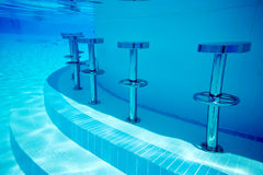 Underwater seats in pool Royalty Free Stock Photos