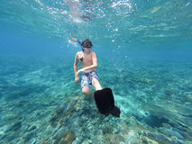 Underwater shoot of a young boy snorkeling. And diving in a tropical sea in Nusa penida, Indonesia, Bali Royalty Free Stock Photo