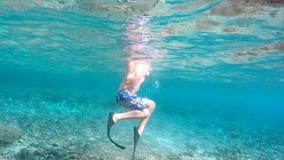 Young boy snorkeling, Bali, Indonesia. Underwater shoot of a young boy snorkeling and diving in a tropical sea in Nusa penida, Indonesia, Bali stock footage