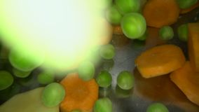 Underwater shot of fresh vegetables being dropped into the water. Cooking vegetable soup in metal pot: green peas, carrots, potato. Es stock footage