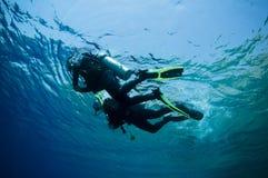 Underwater Shot Of Scuba Divers Stock Photo