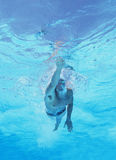 Underwater shot of professional male athlete swimming in pool stock photo