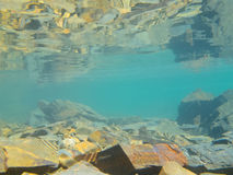 Underwater shot in shallow water over rocky bottom Stock Images